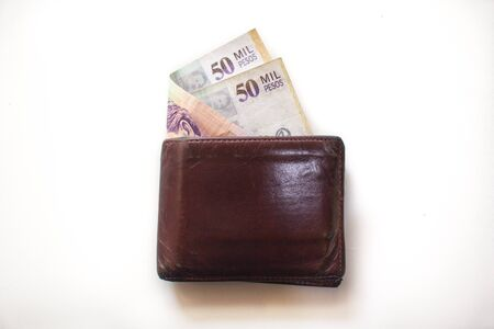 Wallet with 50000 Colombian pesos bills sticking out
