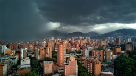Medellin Colombia Rain storm with clouds approach city with buildings in shot. Latin  South America