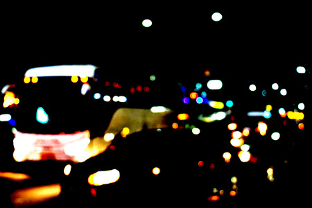 Real Light blur bokeh in dark background from lens out focus. Red blue green yellow light neon at bar.it look like circle light many color blur at night on street in big city in celebration time Stock fotó