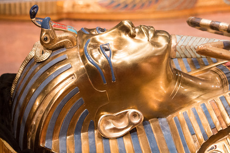 verticals: King tut head shot laying down