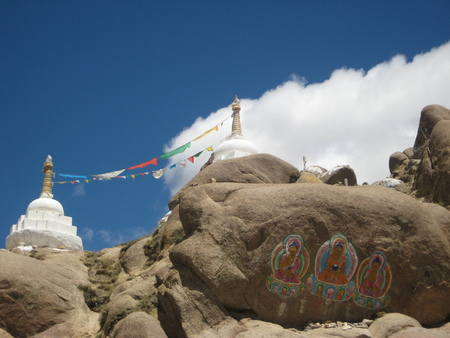 buddhist stupa: Cairn. Buddhist stupa, choyten. Drawings on the rocks.