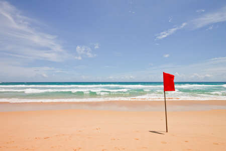 Red flag at the beach, Phuket, Thailand photo