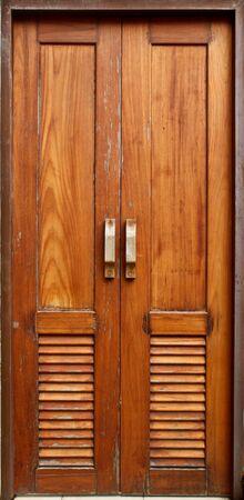 Old wooden door in closed position photo