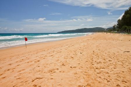 Sand and sea at the beach, Phuket Thailand photo