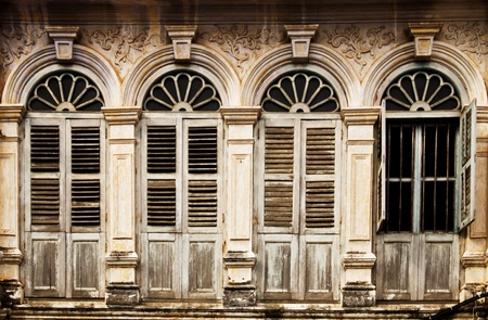 plaster: Old windows in Shino-Portugese style, Phuket Thailand Stock Photo