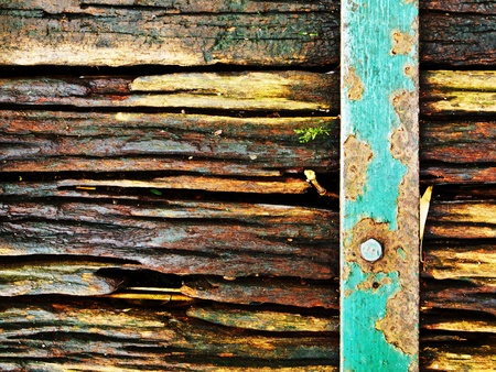old wood suface with rusty steel photo