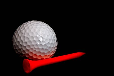 Golfball with plastic tee photo