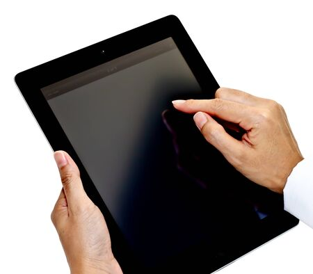 Hands of business woman using tablet PC photo