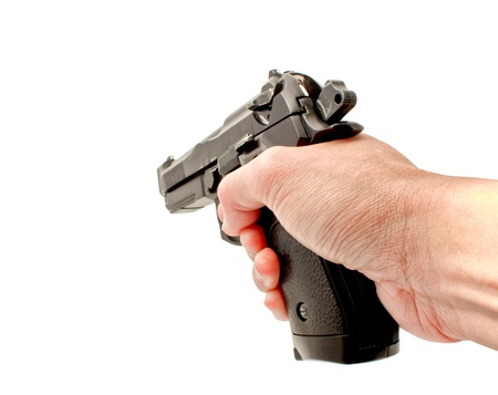 A hand holding a automatic handgun ready to shoot, studio shot