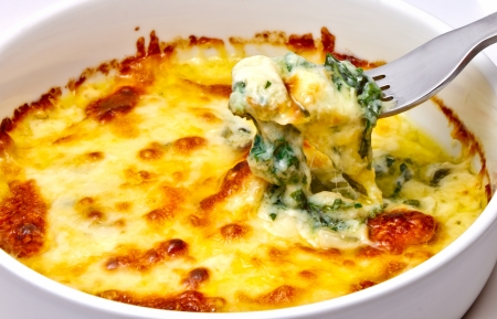 Baked spinach with cheese ready from oven