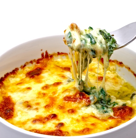 pasta fork: Baked spinach with cheese ready from oven