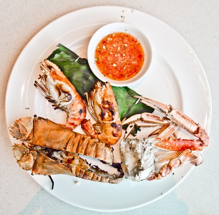 Grilled seafood with spicy souce photo