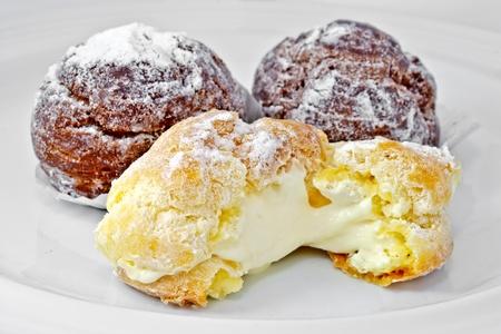 cream puff: eclair, vanilla and  chocolate favor