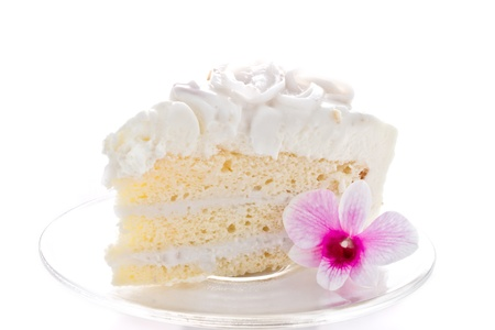 A piece of coconut cake with orchids Stock Photo - 10366270