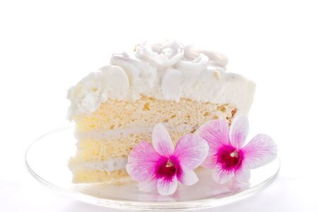 A piece of coconut cake with orchids photo