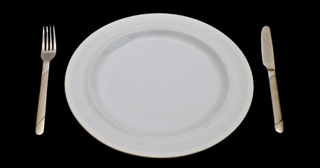 white plate with knife and fork photo