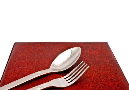 spoon and fork on leather menu cover photo