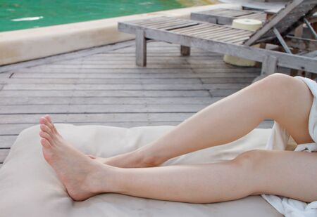 legs of lady at swimming pool photo