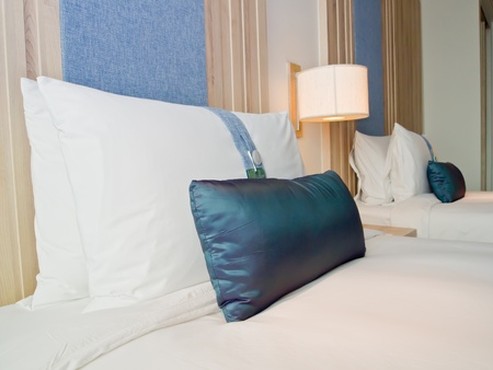 pillows on beds in a luxury hotel