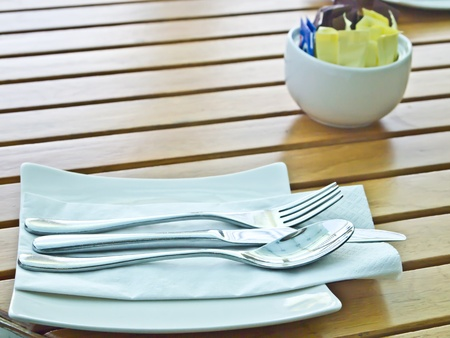 a set of knife, fork and spoon on a table photo