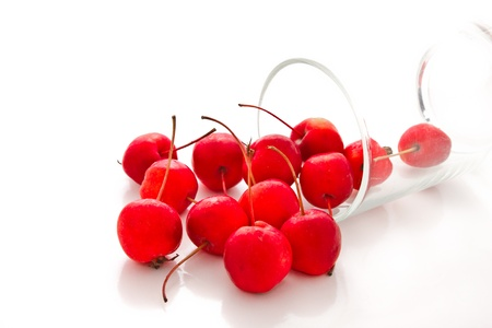 duet: cherry and glass on white background