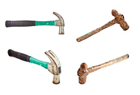 housebuilding: set of old rusty and modern used hammers