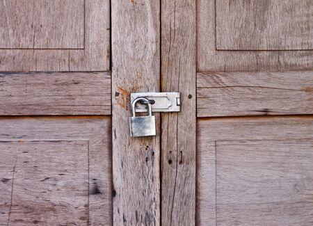 old wooden door locked with padlock photo