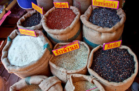 many kinds of raw rice at the market in Thailand photo