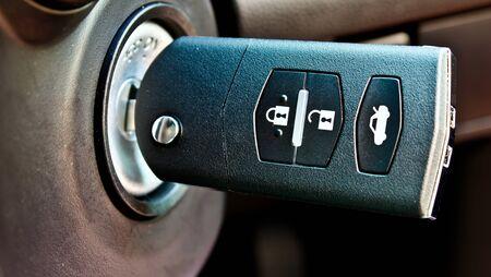 a car key in key hole Stock Photo - 12345331