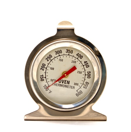 bakery oven: oven thermometer on white background Stock Photo