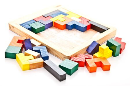 unfinished wooden jigsaw on white background Stock Photo - 12345312