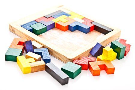 unfinished: unfinished wooden jigsaw on white background Stock Photo