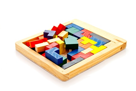 unfinished wooden jigsaw on white background Stock Photo - 12345310