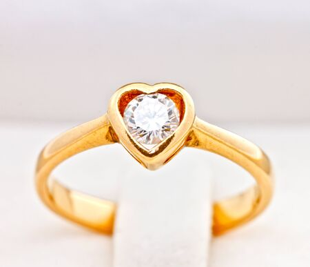 gold wedding ring with diamond, heart shape photo