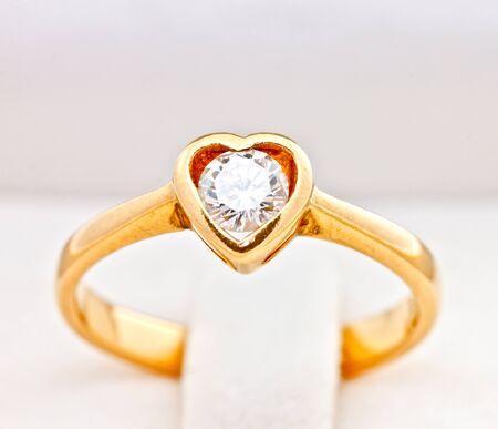 gold wedding ring with diamond, heart shape photo
