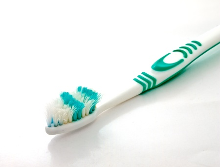 a used toothbrush on white background Stock Photo - 12345377