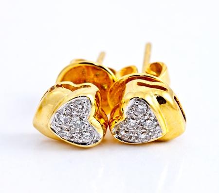 coeur diamant: une paire de boucle d'oreille en diamant en forme de coeur Banque d'images