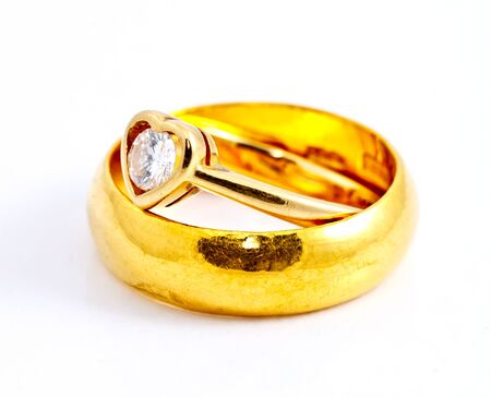 two wedding rings on white background photo
