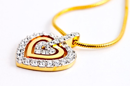 heart shape diamonds locket on white background photo