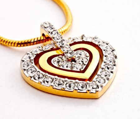 jewelry chain: heart shape diamonds locket on white background