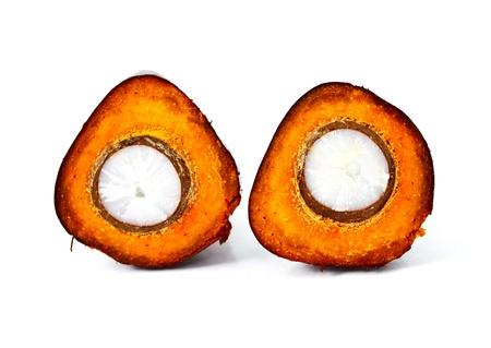 red palm oil: closeup shot of a cut oil palm fruit
