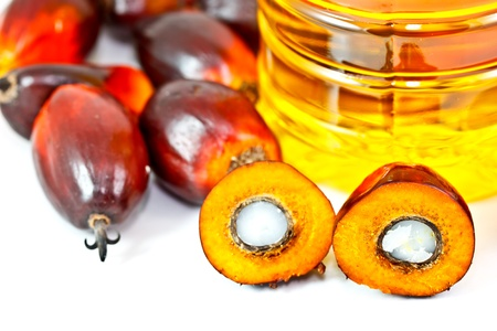 palm fruits: oil palm fruits and palm oil Stock Photo