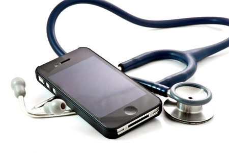 medical concept, smart phone and stethoscope - diagnosing the problem via mobile phone  Stock Photo