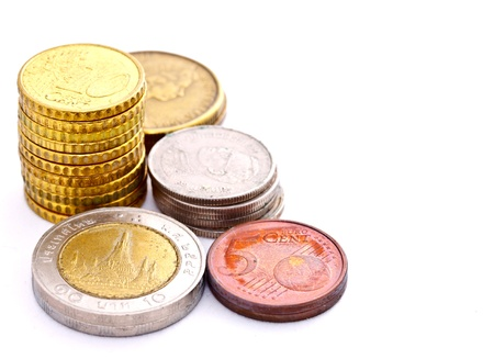 tower of many nations coins on white background photo