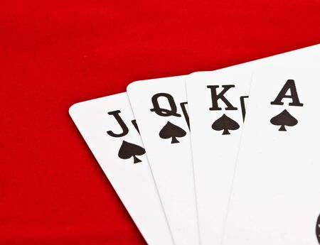 playing cards on red table photo