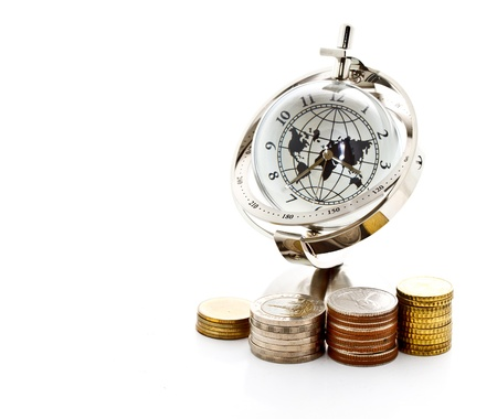 towers of coins with global model clock on white background