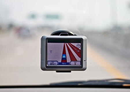 global positioning system: GPS navigator in a car drving on high way Stock Photo