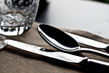 set of spoon and kinfe on dinning table at a fine restaurant Stock Photo