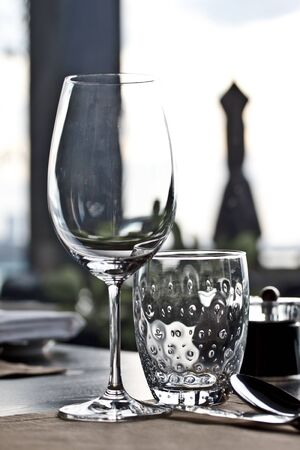 wine and water glass on dinning table at a fine restaurant photo