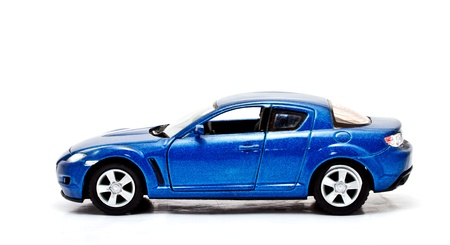 carritos de juguete: deportiva azul modelo de coche en el fondo blanco